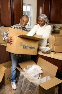 Couple packing boxes