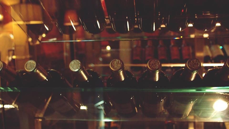 ark wine bottles on glass shelves